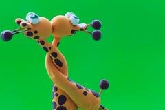 Deux girafes et un baiser Image stock