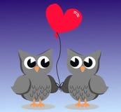 Deux hiboux mignons dans l'amour Image stock