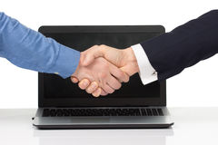 Deux hommes avec l'ordinateur portable Photographie stock libre de droits