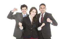 Deux hommes d'affaires élégants et une femme d'affaires dedans Photos libres de droits