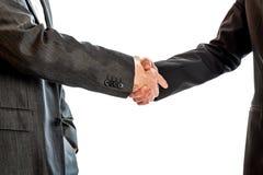 Deux hommes d'affaires, avocats ou politiciens se serrant la main Photos stock