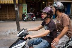 Deux hommes sur un scooter Image libre de droits