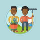 Deux hommes vont planter la fleur Photographie stock libre de droits