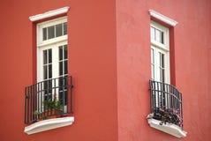 Deux hublots dans buiding rouge Images stock