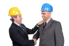 Deux ingénieurs ou architectes, projet neuf se fermant Images stock