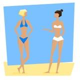 Deux jeunes femmes dans des maillots de bain Photographie stock libre de droits