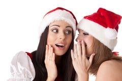 Deux jeunes femmes dans le costume de Santa. Image stock