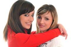 Deux jeunes filles d'isolement sur le blanc Photos stock