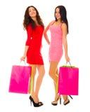 Deux jeunes filles de sourire avec des sacs Photos libres de droits