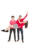 Deux jeunes hommes et une jeune fille se sont habillés en rouge Images stock
