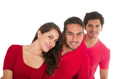 Deux jeunes hommes et une jeune fille se sont habillés en rouge Photos stock