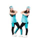 Deux jeunes majorettes professionnelles posant au studio Photographie stock