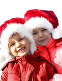 Deux jeunes Santa ! Image stock