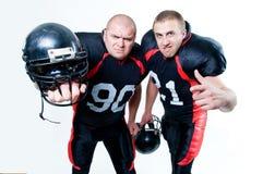 Deux joueurs de football américain Images stock