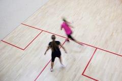 Deux joueurs féminins de courge Image stock