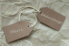 Deux labels Merci Beau Means Thank Paper Background Images stock