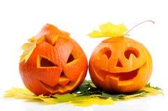 Deux lanternes oranges de Jack O de potirons de veille de la toussaint Photo stock