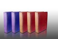 Deux livres bleus et livre de trois rouges Photographie stock libre de droits