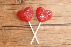 Deux lucettes rouges de forme de coeur Photo libre de droits