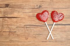 Deux lucettes rouges de forme de coeur Image stock