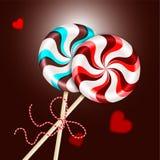 Deux lucettes rouges rayées rondes de brun bleu avec la corde décorative et coeurs brouillés Baie et bonbons au chocolat sur a illustration libre de droits