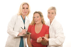 Deux médecins avec le patient Photo stock