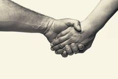 Deux mains - amitié Photos stock