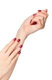 Deux mains de femme avec l'ongle rouge Photo libre de droits