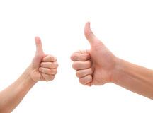 Deux mains effectuant des pouces lèvent le geste Photographie stock