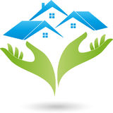 Deux mains et trois maisons, toits, logo d'immobiliers Photographie stock libre de droits