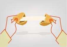 Deux mains fendent un biscuit de fortune pour indiquer un calibre de message Clipart (images graphiques) Editable Photographie stock libre de droits