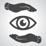 Deux mains prennent soin de l'icône d'oeil Photos stock