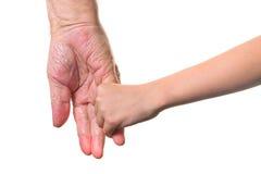 Deux mains se retenantes Photo stock