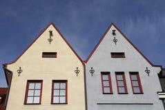 Deux maisons sur la lumière du soleil Image stock