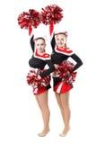 Deux majorettes professionnelles posant au studio Les mains ont augmenté vers le haut Photo stock