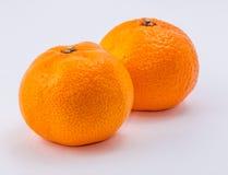 Deux mandarines sur le fond blanc Photos stock