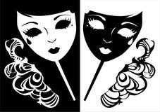 Deux masques pour une mascarade. image stock