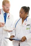Deux médecins dans la discussion lourde Image stock