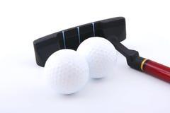 Deux mini billes et clubs de golf Photographie stock
