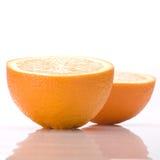 Deux moitiés d'une orange Image libre de droits