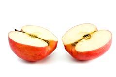 Deux moitiés rouges de pomme Photographie stock libre de droits