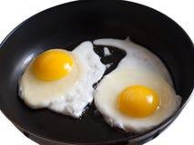 Deux oeufs au plat sur la casserole Photographie stock libre de droits