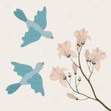 Deux oiseaux et branchement de floraison illustration libre de droits