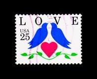 Deux oiseaux et coeurs, question d'amour, vers 1990 Photos libres de droits