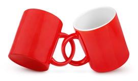 Deux ont couplé les tasses rouges Photos stock