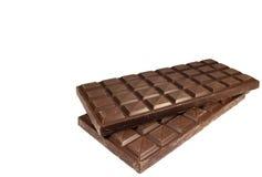 Deux ont empilé des barres de chocolat d'isolement sur le fond blanc avec l'espace libre pour le texte Photos libres de droits