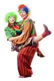 Deux ou trois clowns joyeux Photos stock