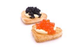 Deux pains grillés en forme entendue avec le caviar Photographie stock