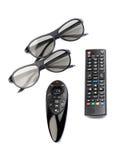 Deux paires des verres 3D et de la TV à télécommande Photo libre de droits