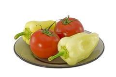 Deux paprikas et deux tomates Photos stock